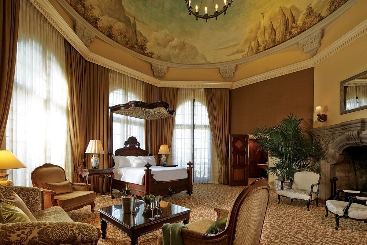 room at Mission inn with large bed, fireplace, accent chair and