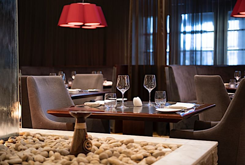 A view of an arranged dining area at the Duxton Hotel Perth