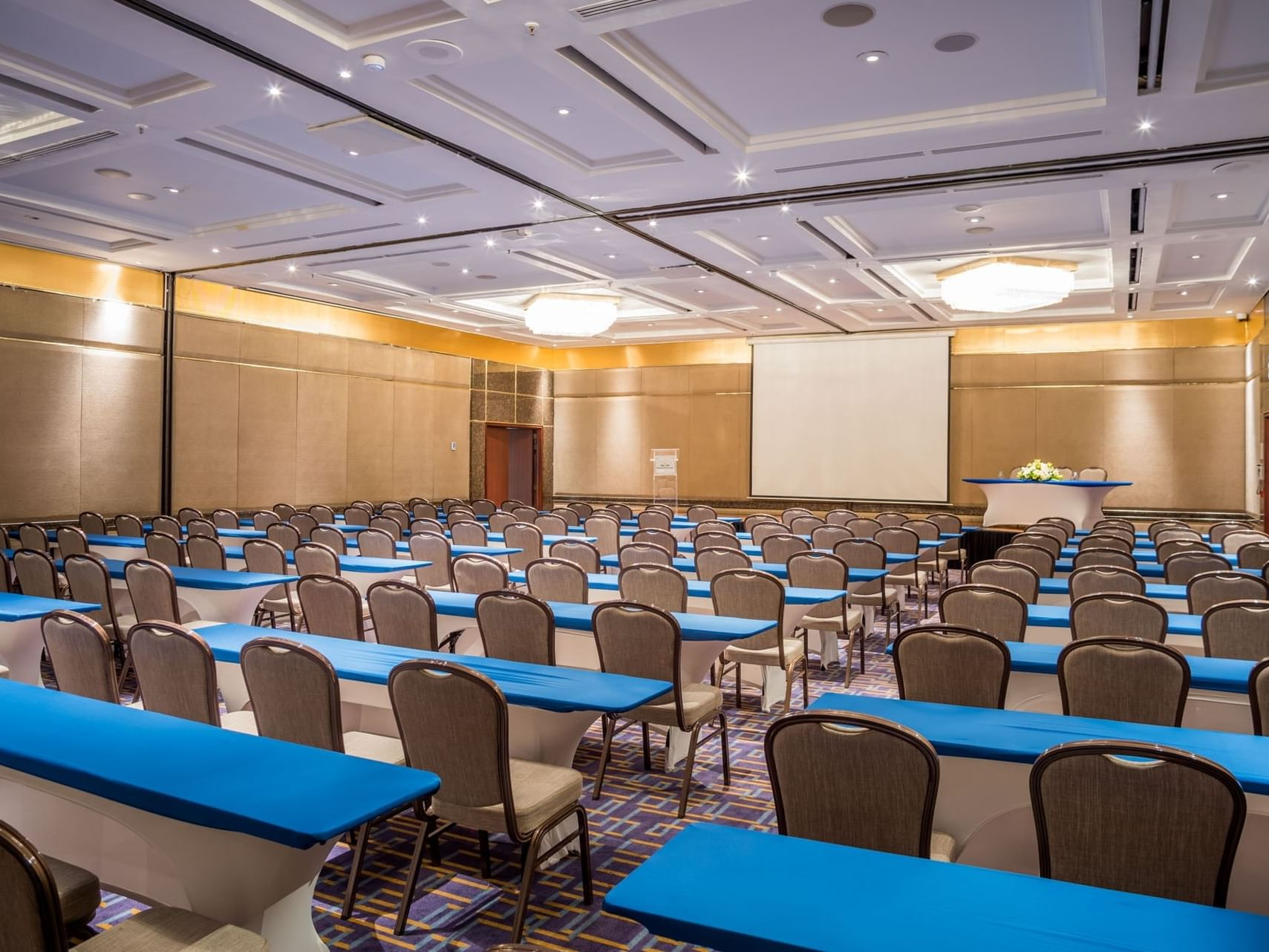 Arranged Santa Fe room with a projector at Bogota Plaza Hotel