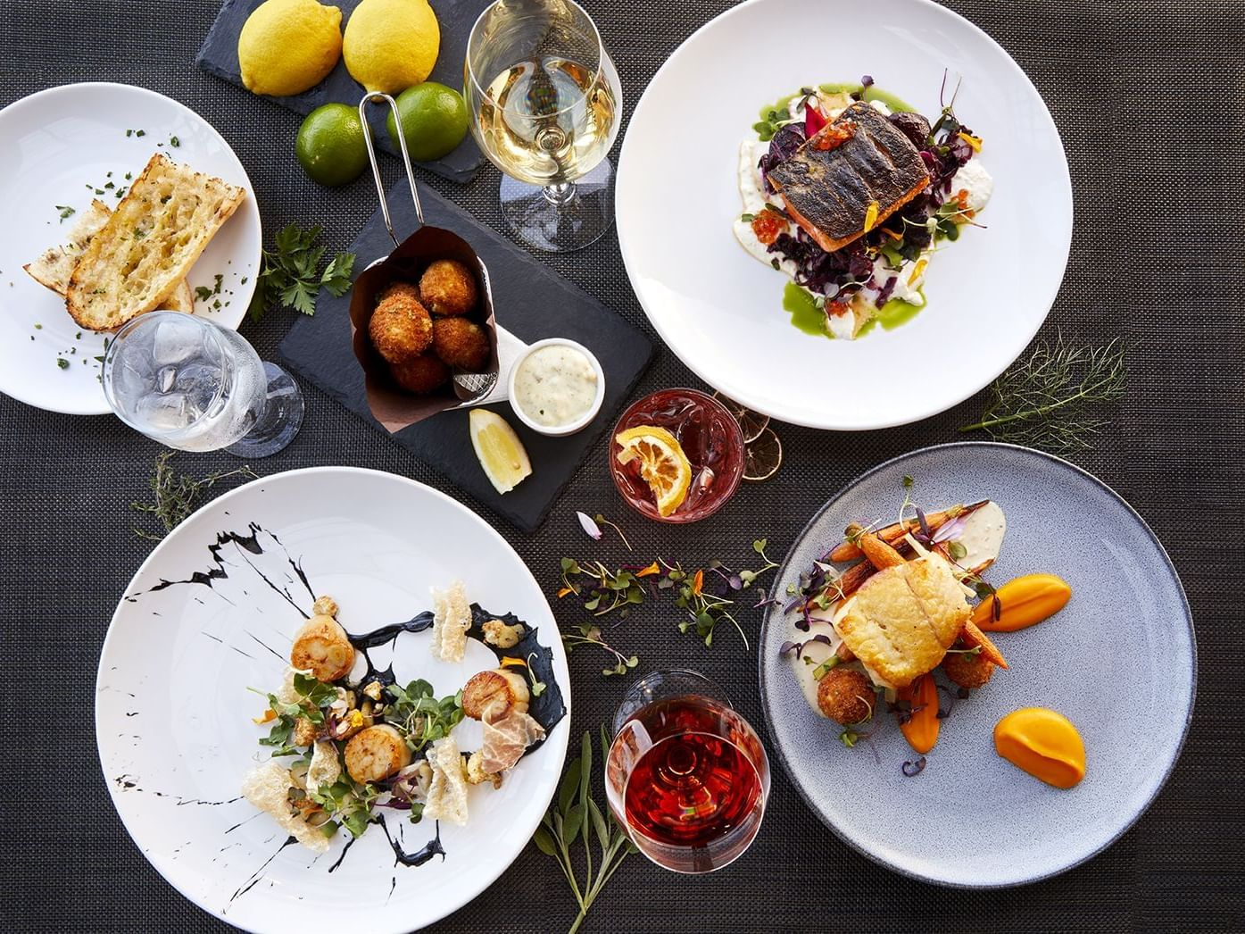 Menu dishes prepared for dining at Granville Island Hotel