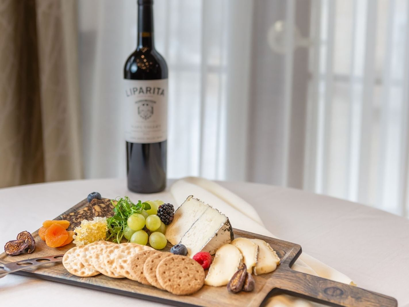 assorted cheese, crackers, fruit and wine