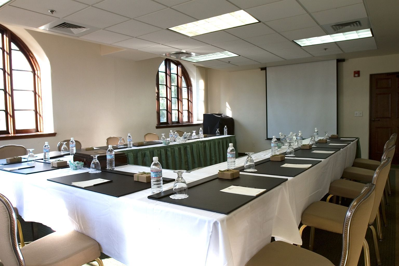 conference room with u-shaped table and projector