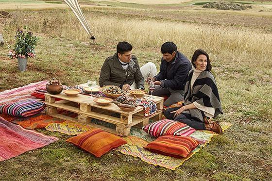 Tourists having a picnic near a paddy field near Hotel Sumaq