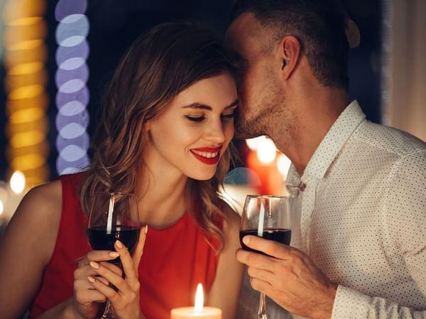 A man whispering his lady at Holiday Inn Montego Bay