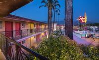 The Safari Inn a Coast Hotel Burbank Lot at Night