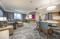 Living room and dining area in Coast Premium Two Bedroom Suite
