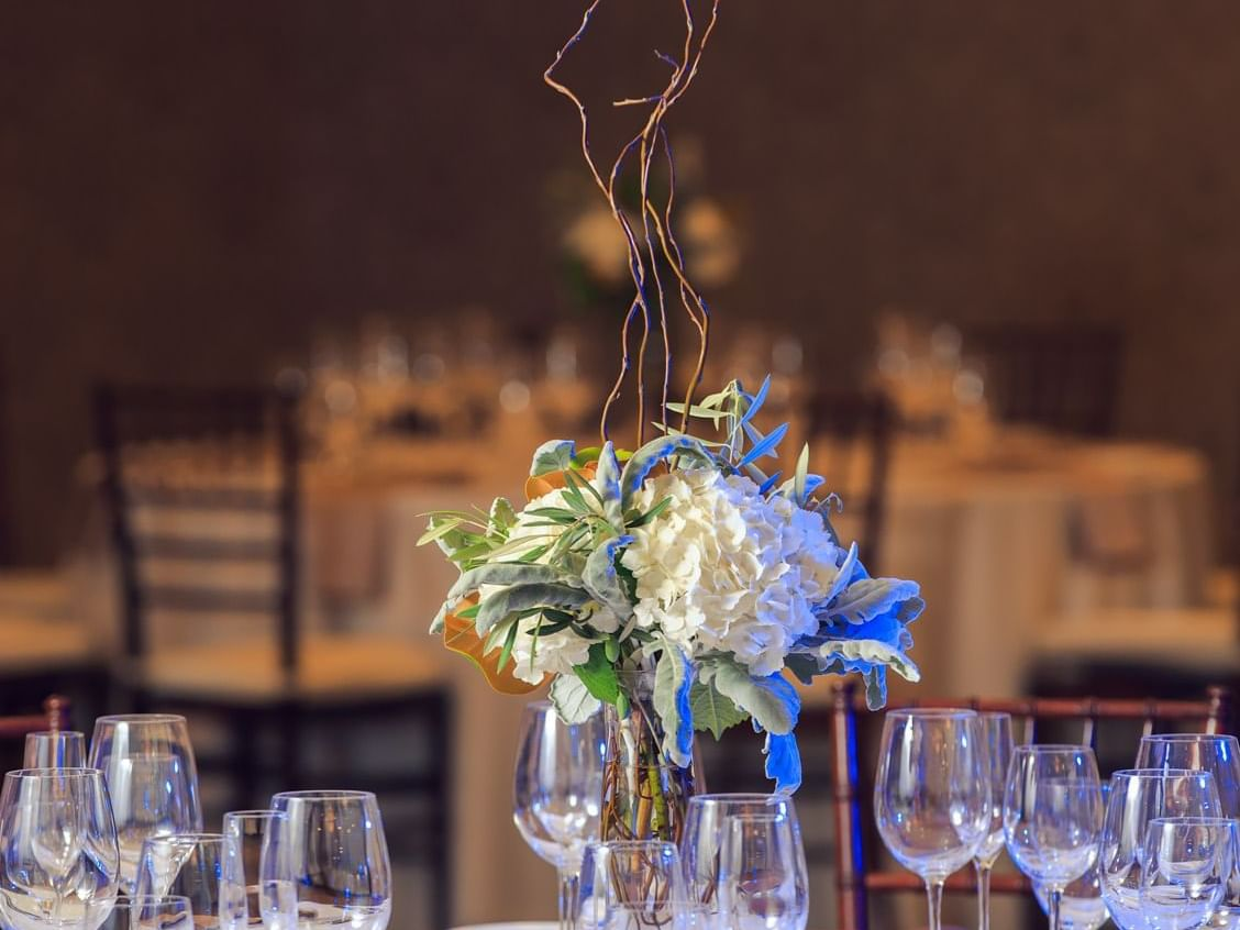 Banquet table with flower centerpiece and wine glasses