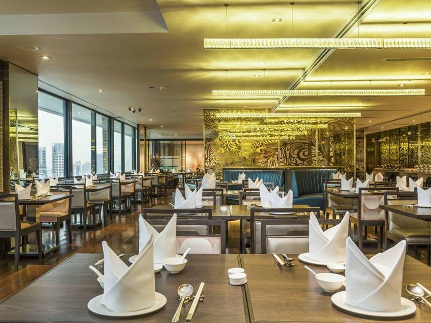 Elegant and spacious dining area of Emporia Restaurant at Emporium Suites by Chatrium