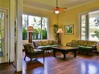 Living room in a cottage at Waimea Plantation Cottages