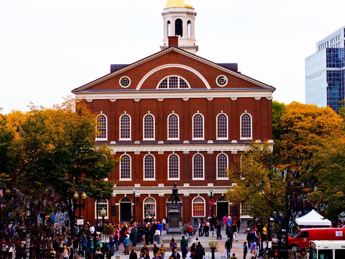 a group of people in front of a red building