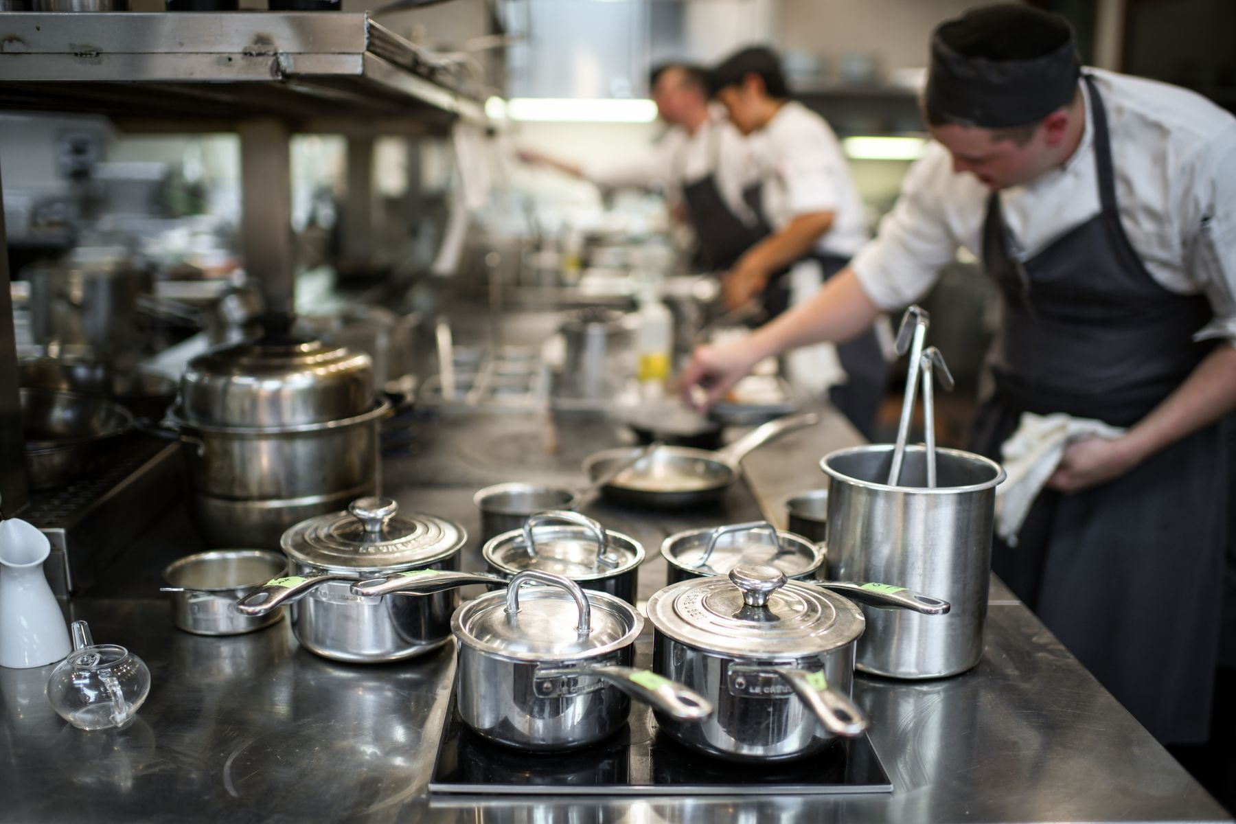 Chef handling pots and pans