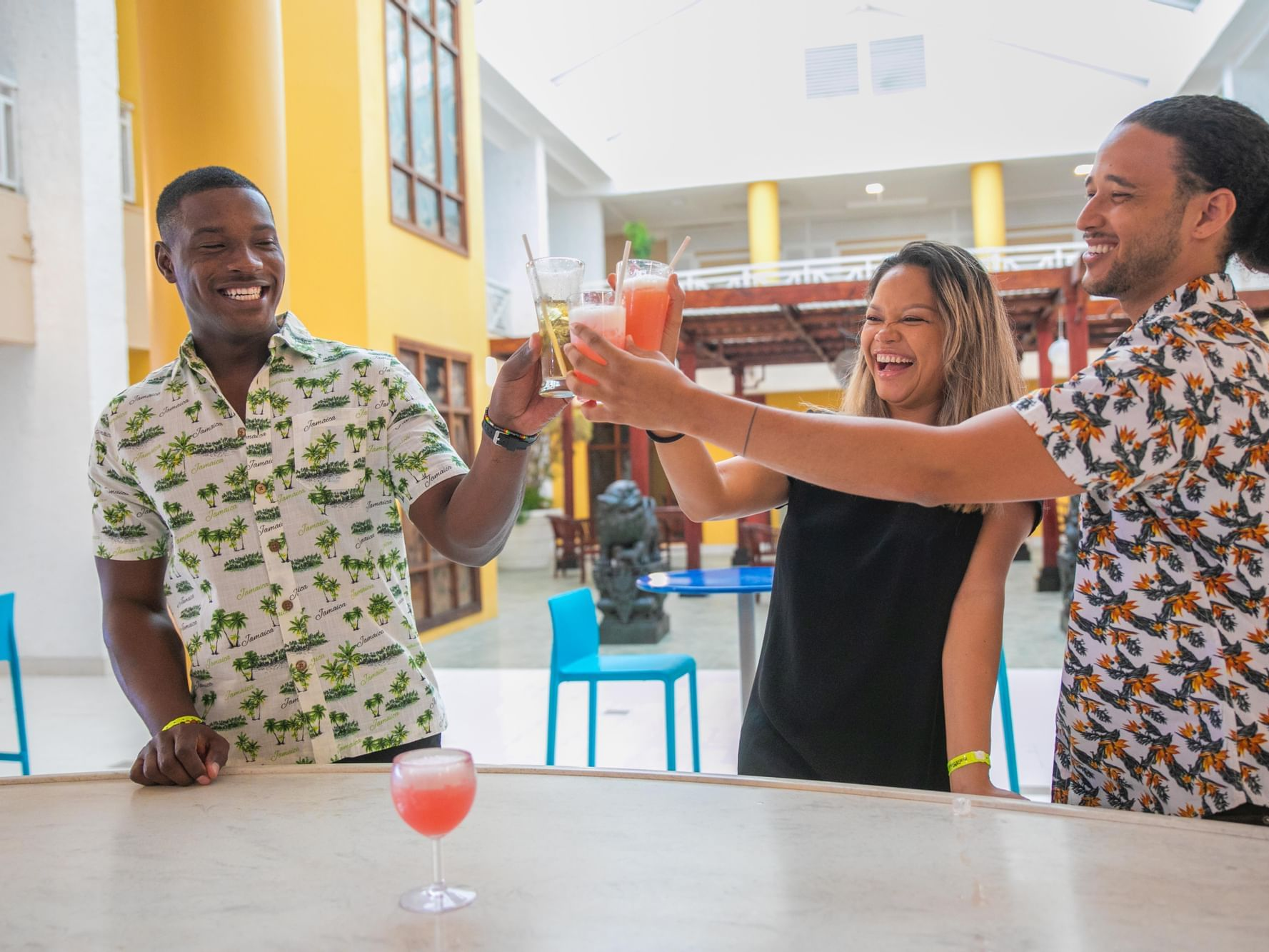 3 people toasting in De Lobby Bar at Holiday Inn Montego Bay