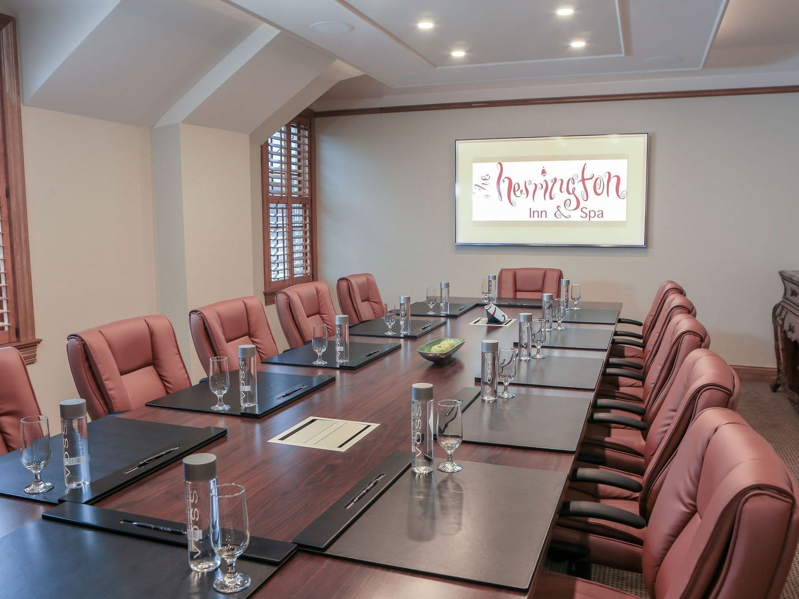 a large meeting desk and chairs