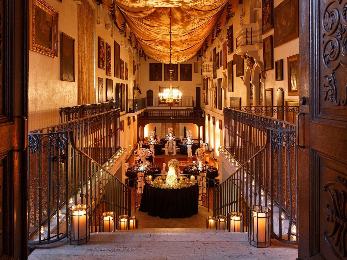 staircase to ballroom with tables