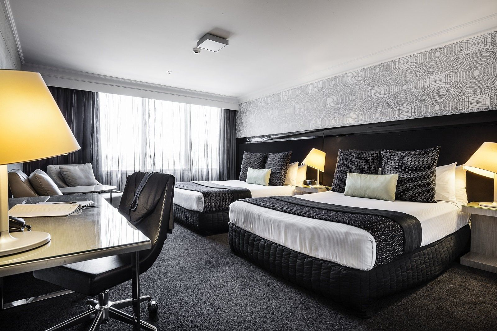 Double bed room with out door view at at Pullman & Mercure Brisb