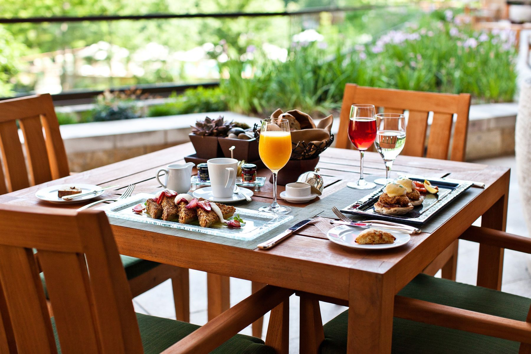 table with breakfast dishes and mimosas