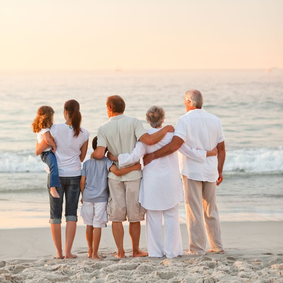 Multigenerational Family on the beach at dusk
