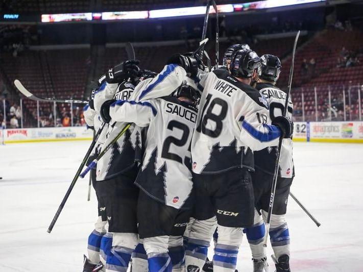 a hockey team huddling up