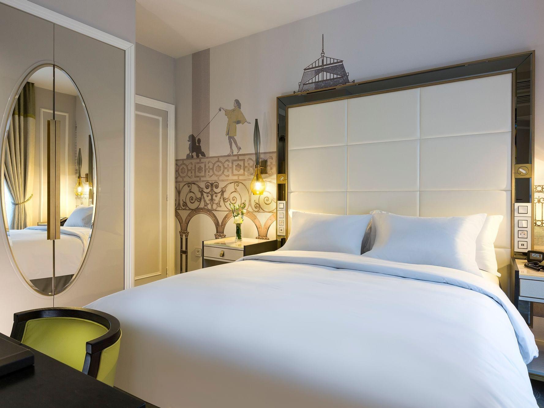 Bed & furniture in Superior Room at Hilton Paris Opera Hotel