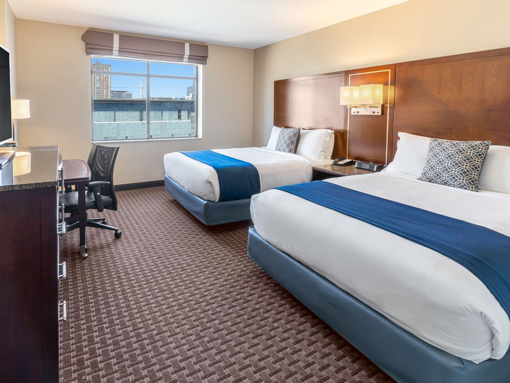 Two Queen Guestroom with two beds at New Haven Hotel