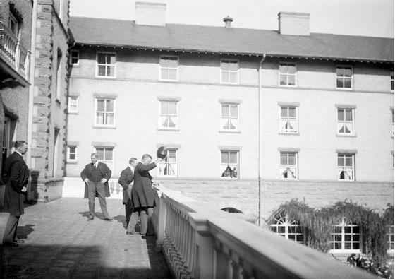 Teddy Roosevelt waving from balcony at Hotel Colorado