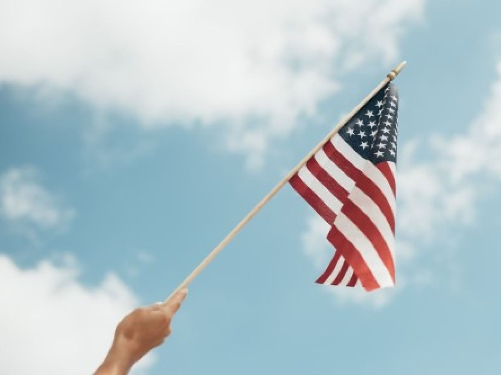 A closeup picture of a person holding the American flag