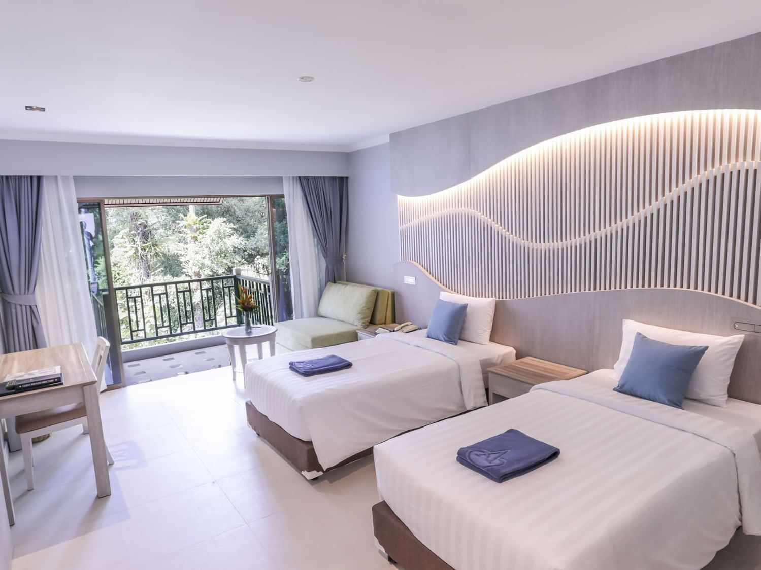 Deluxe Garden View Room at Amora Hotel