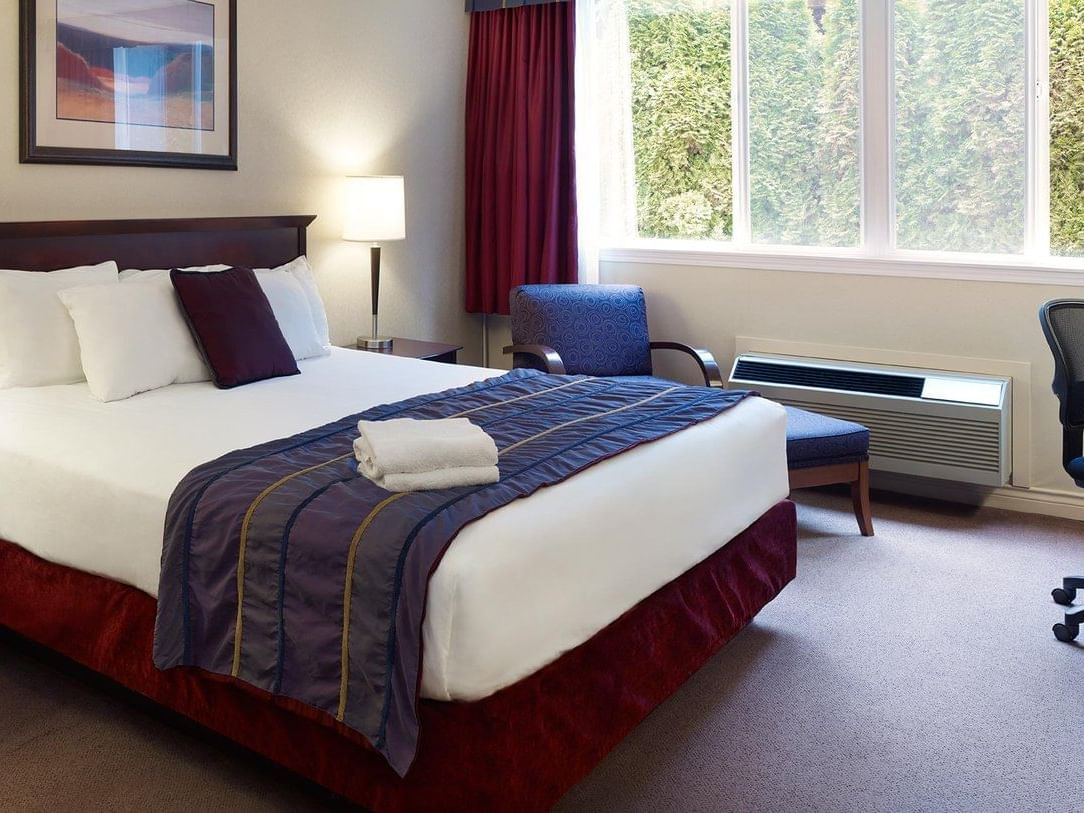 bed in hotel room with window