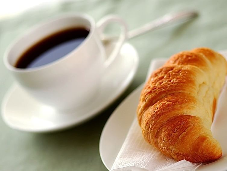 Coffee and croissant served at Carriage House Hotel