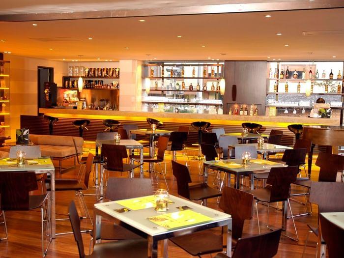 Interior of Bar café with dining area at Bogotá Plaza Hotel