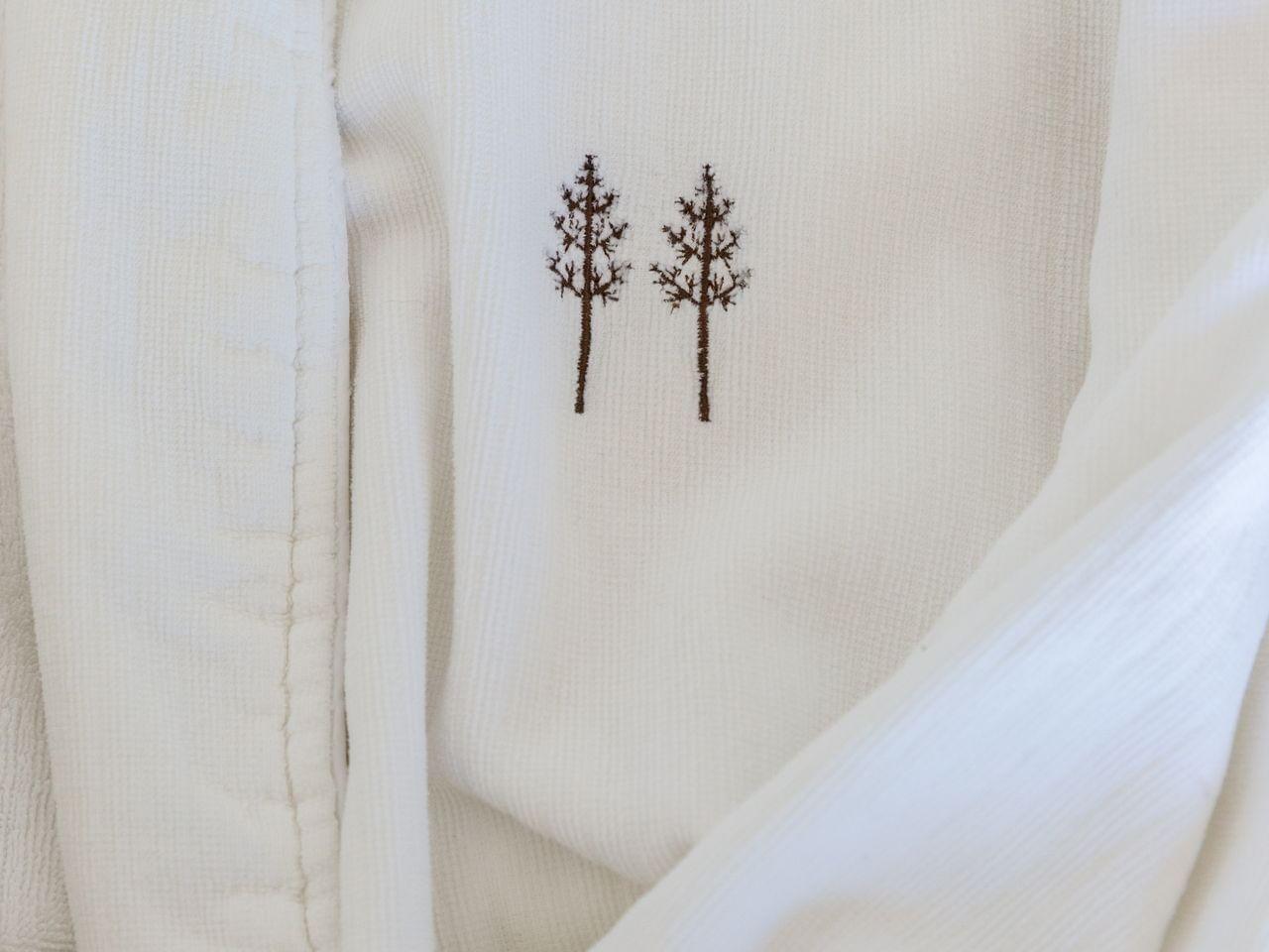 Heritage House Resort logo stitched to a white bathrobe