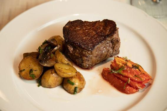 Steak dish served at Hotel Emperador Buenos Aires