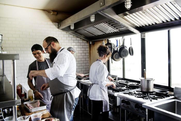 Chefs prepping food in kitchen