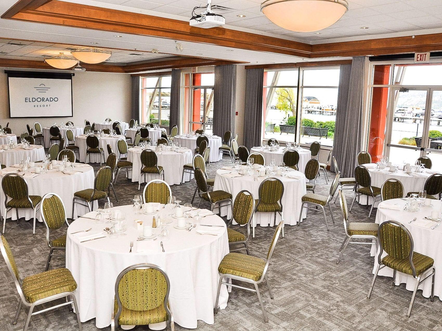 Ballroom with wedding reception arrangements at Manteo Resort