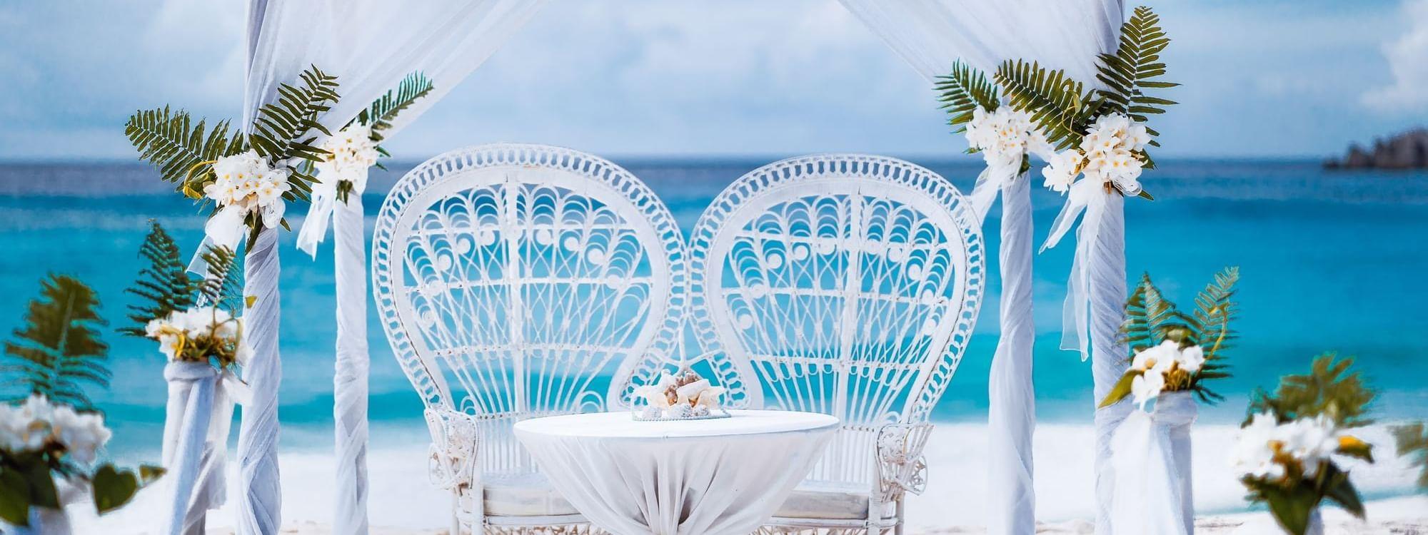 Wedding couch decorations on beach at Daydream Island Resort