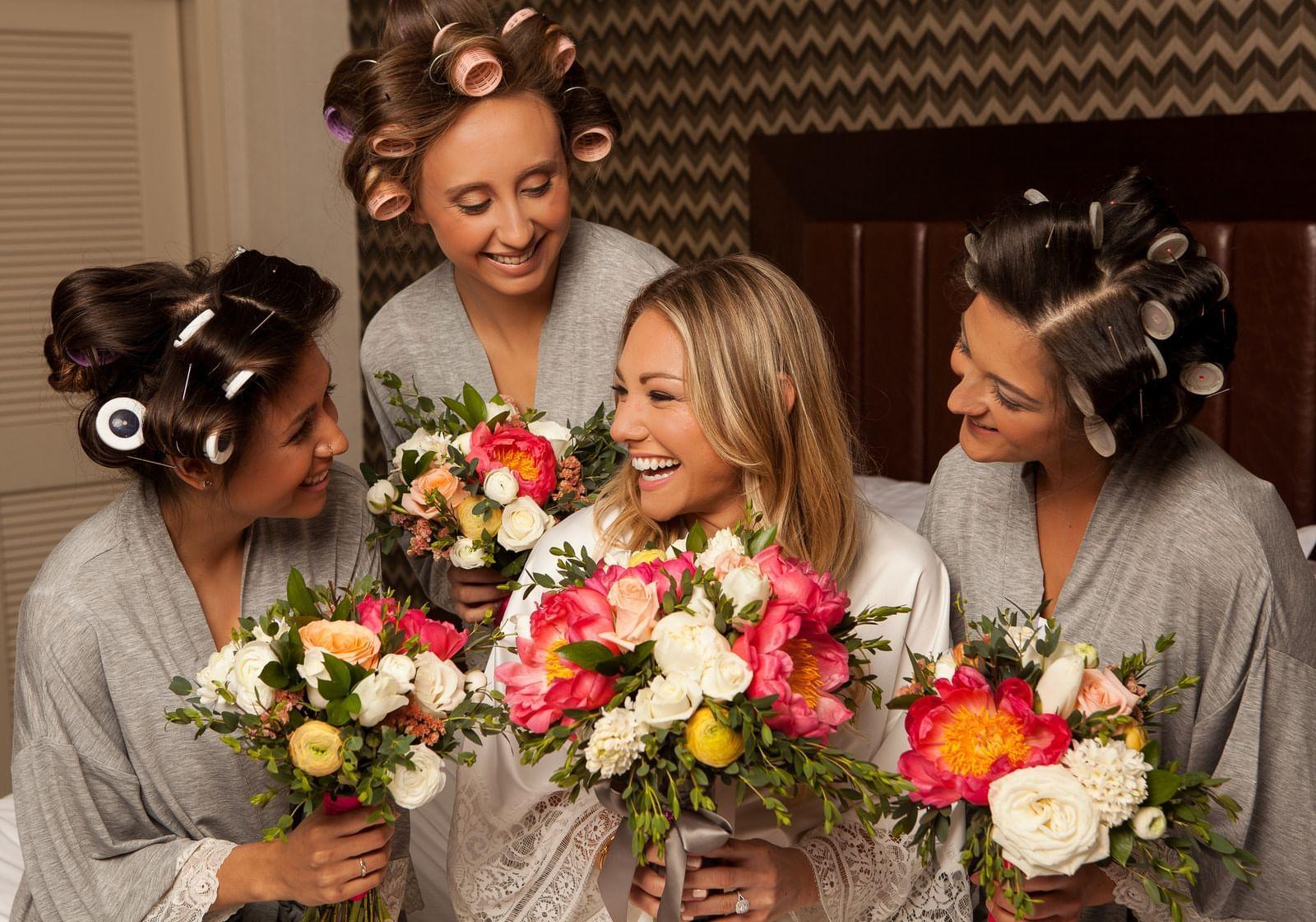 four women holding flowers