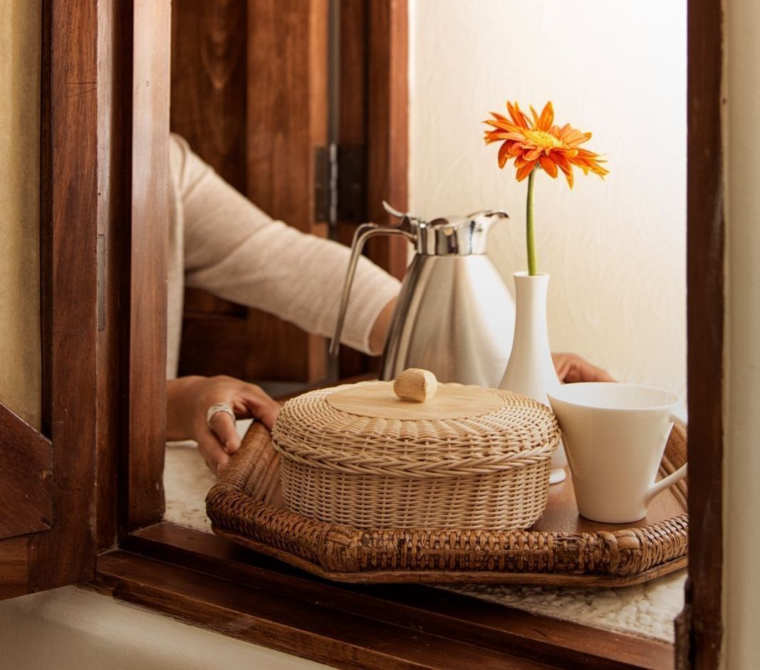 A tray with a basket and coffee cup - Marquis Los Cabos