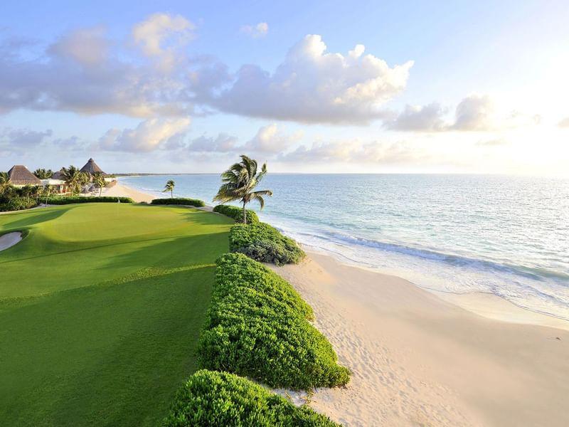 Mayakoba golf court with beachline near The Reef Resorts