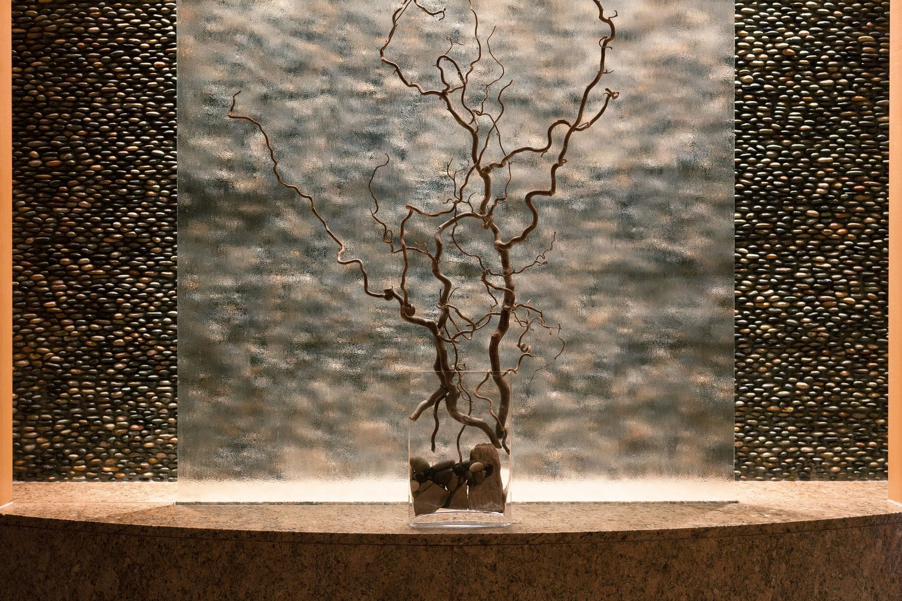 spa water wall with twig