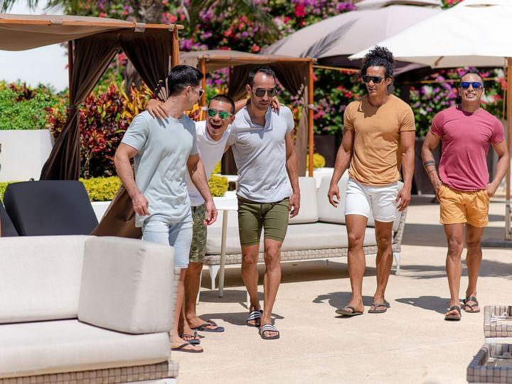 Five men having fun on pool deck at The Reef 28
