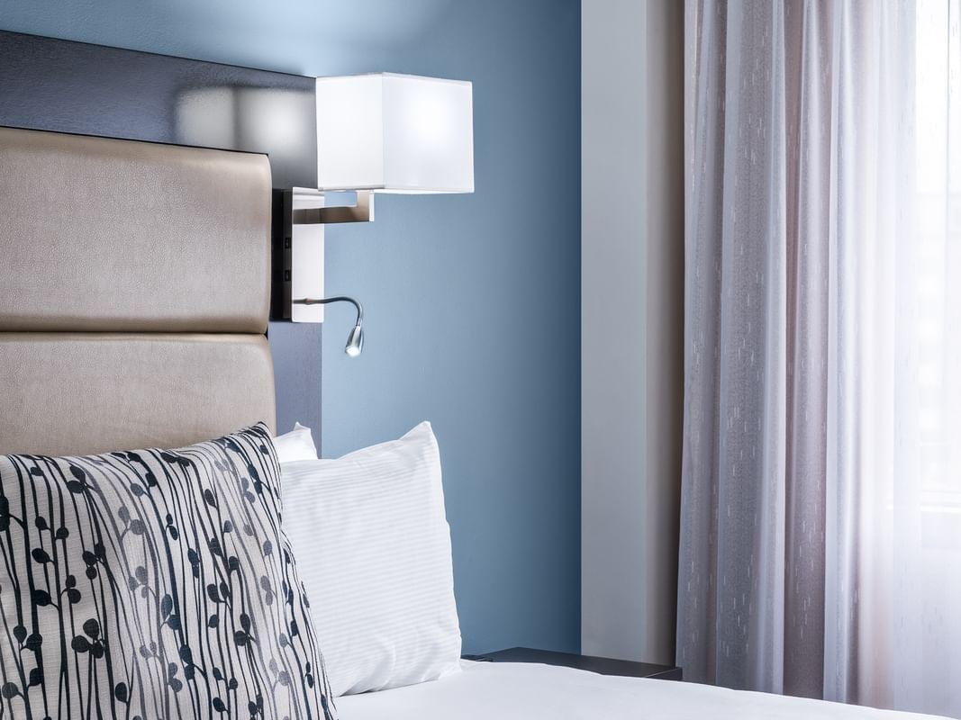 room with bed and wall lamp
