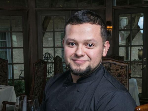 a man in a chefs uniform