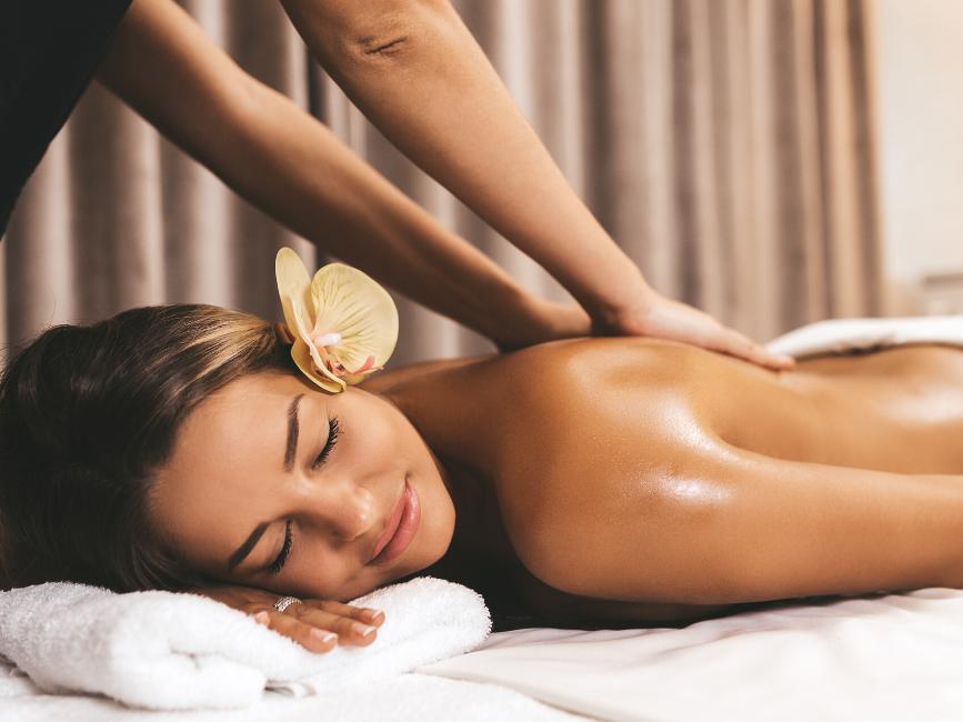 woman having back massage in spa at Amora Hotel