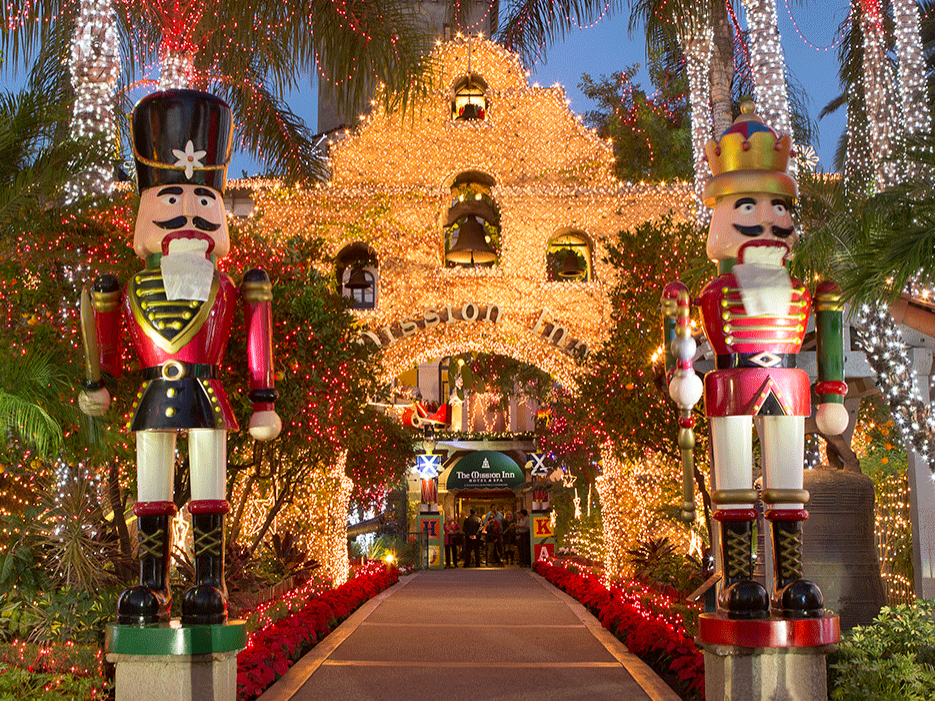 Decorated Mission Inn walkway leading to lobby.