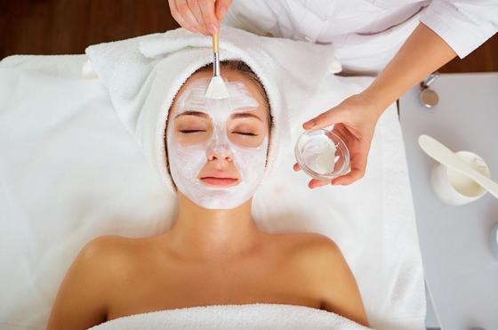 Applying a face mask on lady