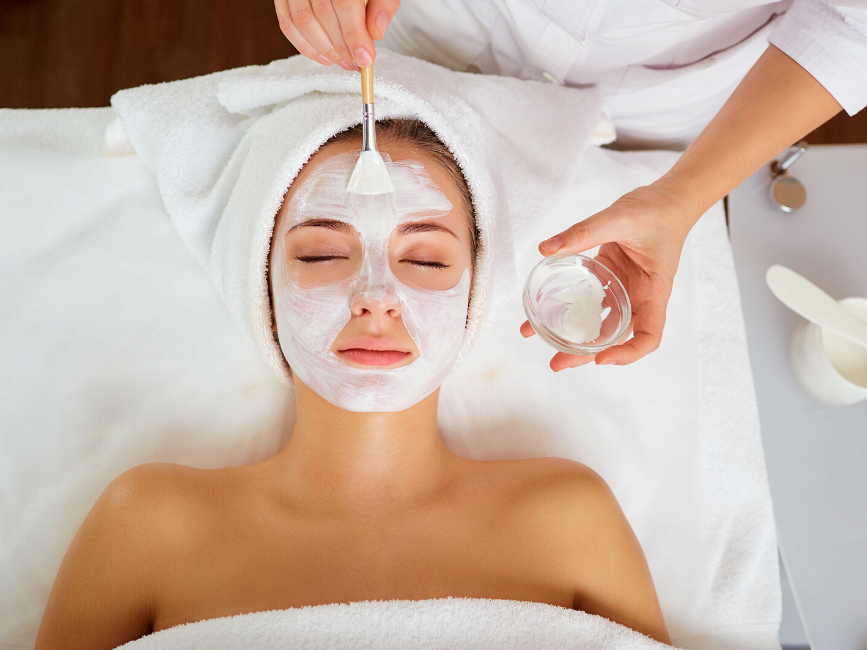 lady having a facial mask treatment at Amora Hotel