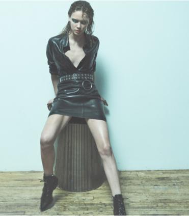 Portrait of a model sitting on wooden stool at Dream Nashville