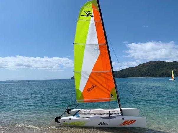 Wind surf boat on beach at Daydream Island Resort