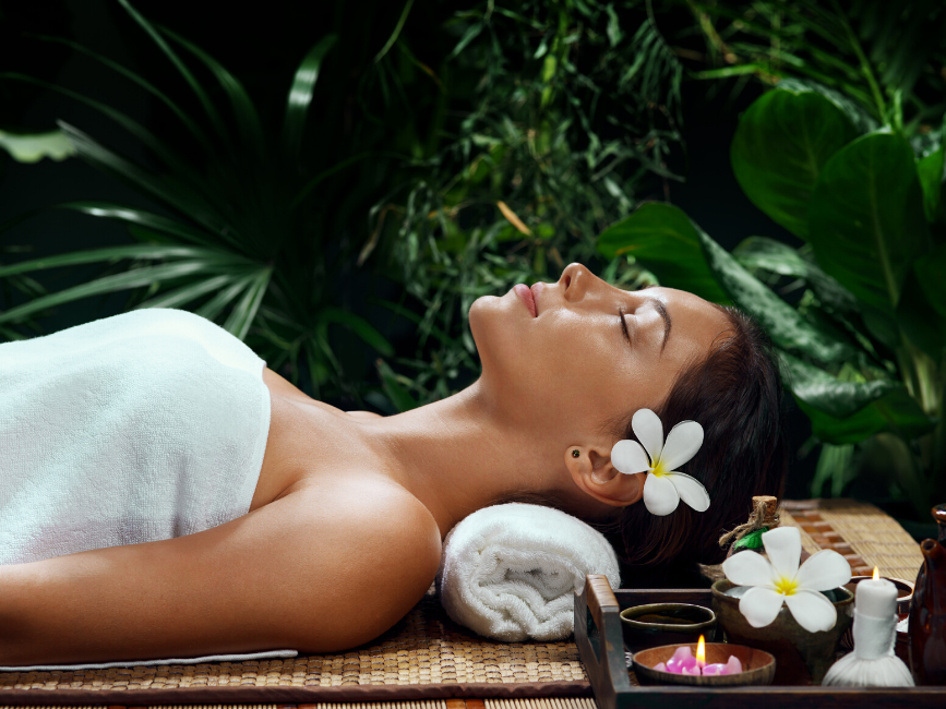 woman lying down for spa treatments at Amora Hotel