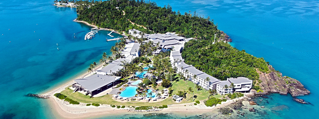 Aerial view of Daydream Island Resort with ocean